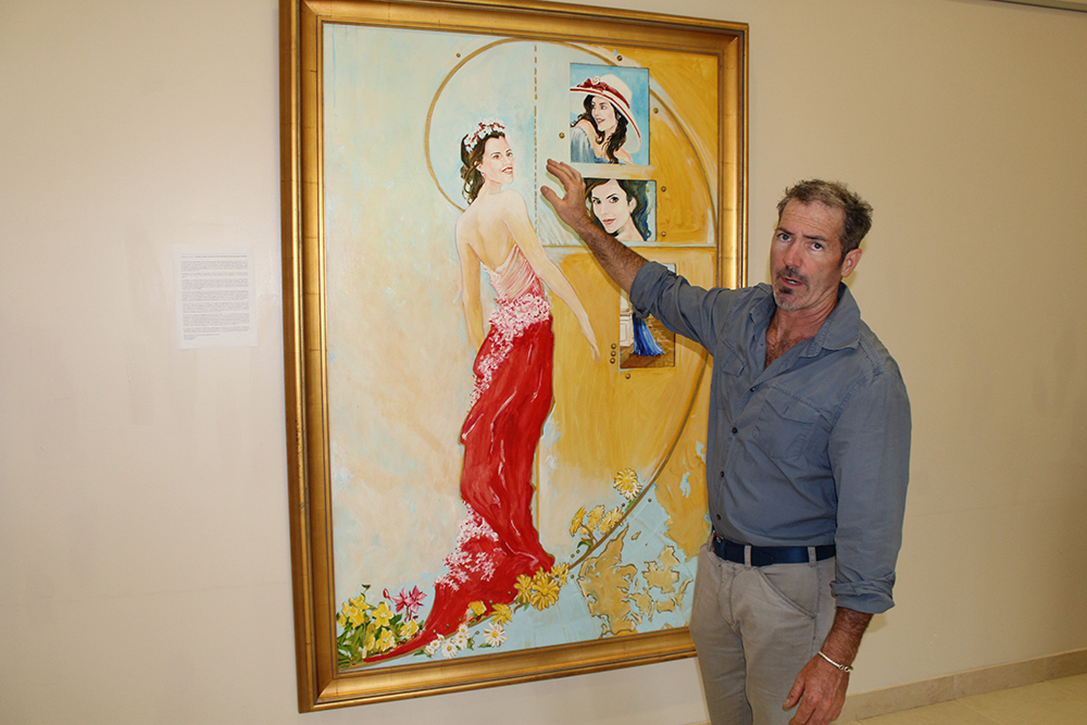 Artist Stan Mullins with his Portrait of the Crown Princess Mary of Denmark